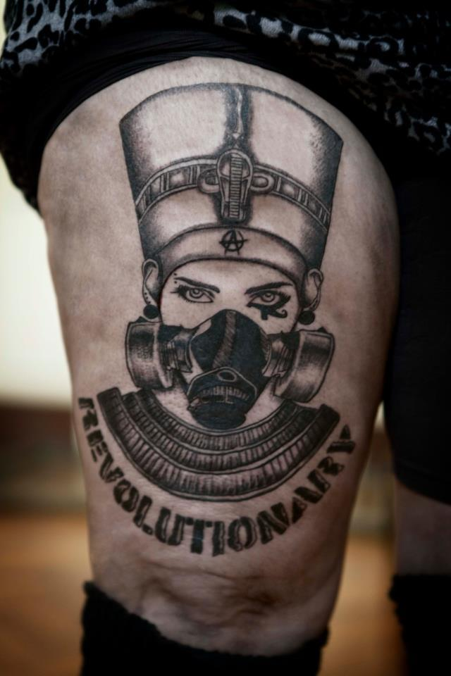 Queen Nefertiti With Gas Mask Tattoo On Thigh