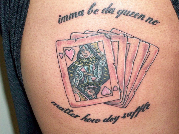 Queen Of Hearts Tattoo On Biceps