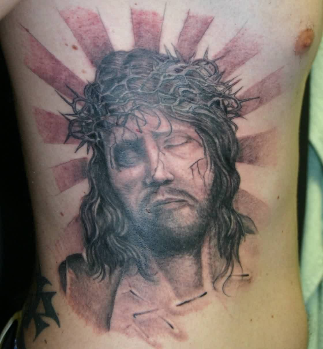 Rays And Jesus Portrait Tattoos On Rib Side