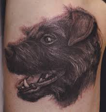 Real Looking Black Animal Face Tattoo