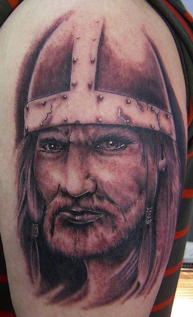 Real Looking Helmet And Viking Head Tattoos On Biceps
