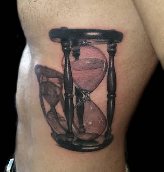 Real Looking Hour Glass Tattoo On Ribs