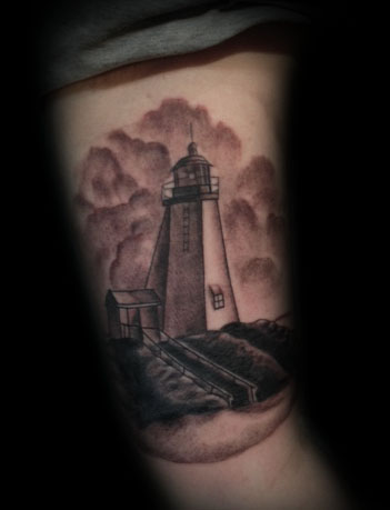Real Looking Lighthouse Tattoo On Arm