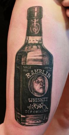 Real Looking Whiskey Bottle Tattoo On Arm