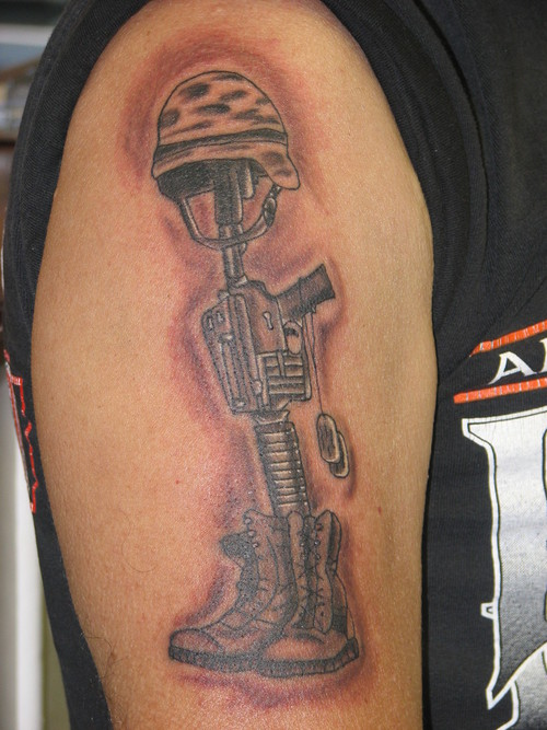 Realistic Helmet On Gun Boot Portrait Tattoo On Biceps