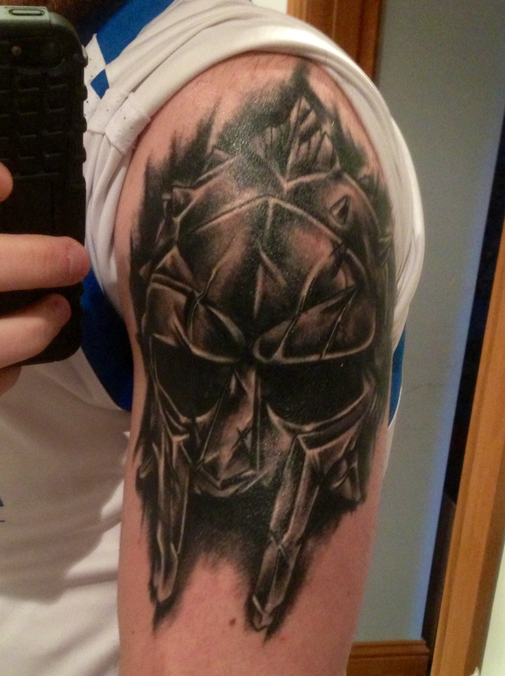 Realistic Helmet Tattoo On Biceps