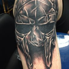 Realistic Helmet Tattoo On Muscles
