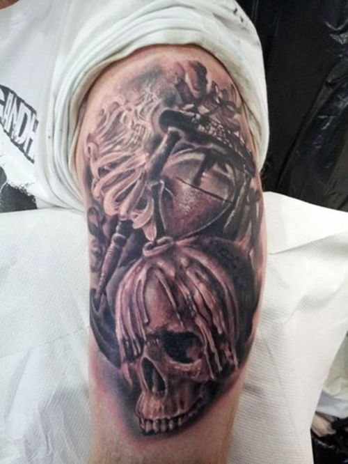 Realistic Hour Glass And Candle Skull Tattoos On Biceps