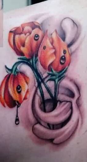 Realistic Orange Tulips Tattoo
