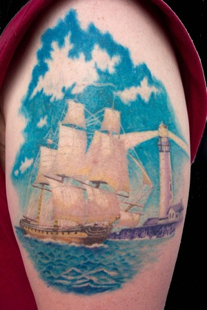 Realistic Sailing Ship And Lightning Lighthouse Tattoo On Biceps