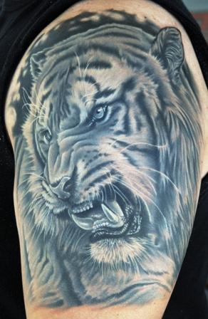 Realistic Tiger Face Tattoo On Half Sleeve