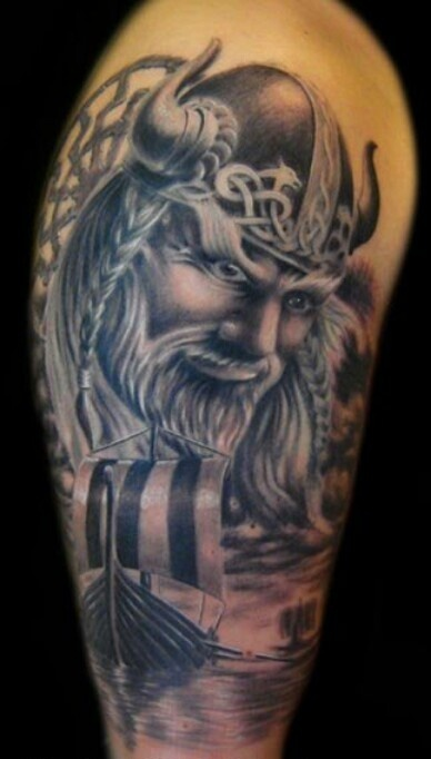 Realistic Viking Head In Helmet Tattoo On Biceps
