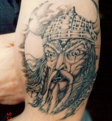 Realistic Viking Helmet Tattoo On Muscles
