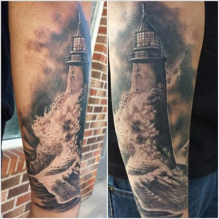 Realistic Waves Hit Lighthouse Tattoo