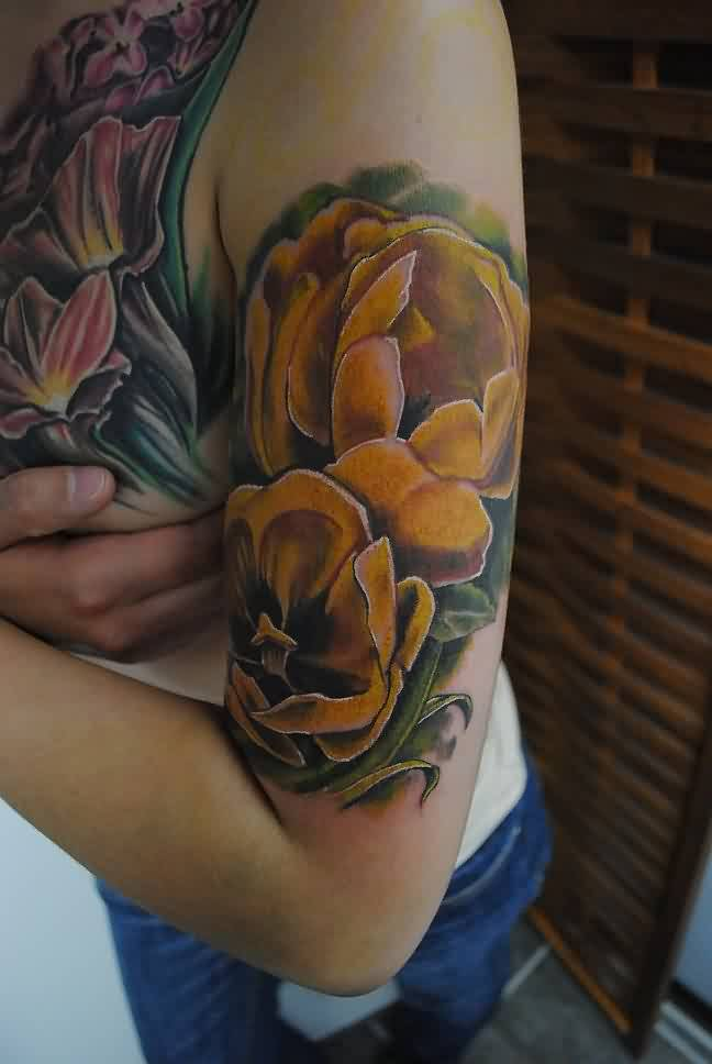 Realistic Yellow Tulip Tattoos On Biceps