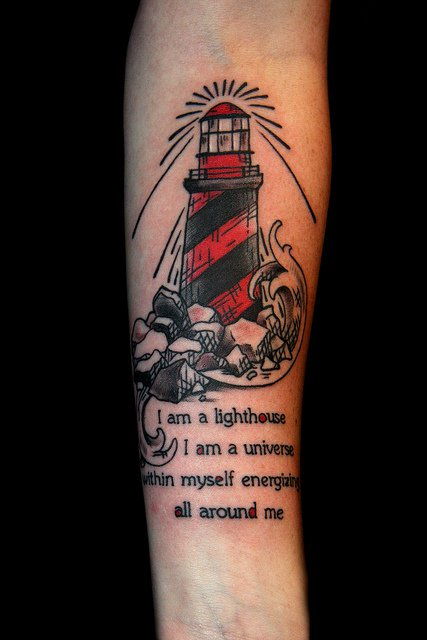Red-Black Lighthouse And Quote Tattoos On Forearm