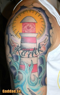 Red Eye Lighthouse And Wave Tattoos On Half Sleeve