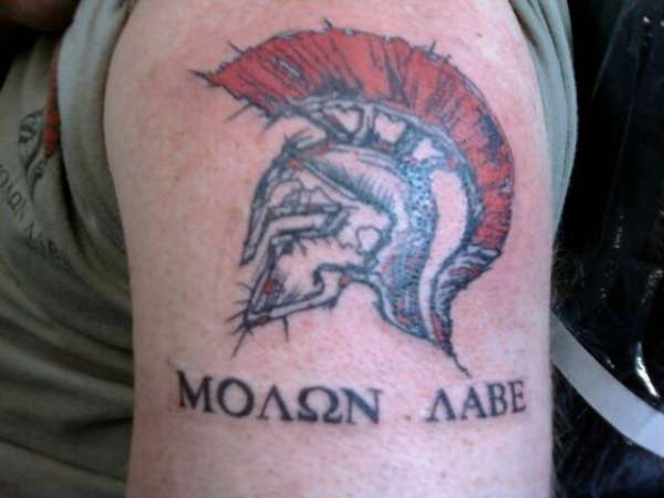Red Haired Helmet Tattoo On Biceps
