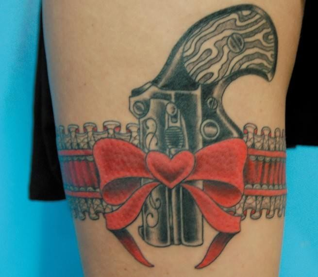 Red Heart Ribbon Pistol Tattoo On Thigh