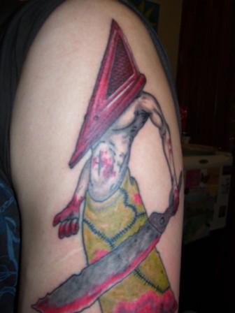 Red Ink Pyramid Head Tattoo On Arm