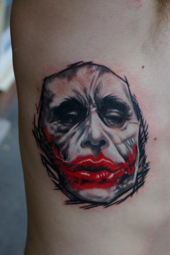Red Lips Joker Portrait Tattoo On Rib Side