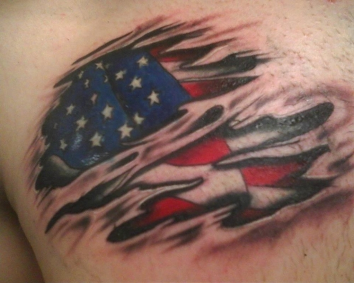 Ripped Skin American Flag Tattoo On Chest