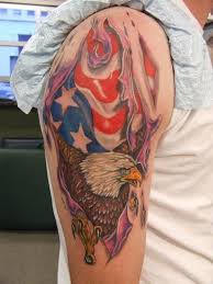 Ripped Skin American Tattoos On Upper Arm