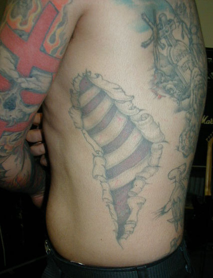 Ripped Skin Bones Tattoo On Ribs