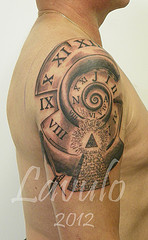 Roman Numerals And Pyramid Tattoos On Half Sleeve