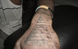 Roman Numerals Pyramid Tattoo On Hand