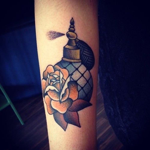 Rose And Perfume Bottle Tattoos On Arm