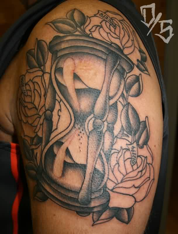 Roses Around Hourglass Tattoos On Biceps