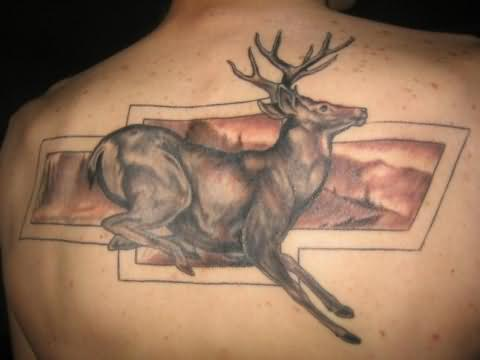 Running Grey Animal And Logo Tattoo On Upperback