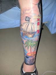 Sailing Ship Lighthouse And Tree Tattoos On Leg