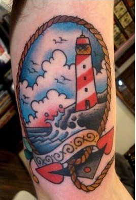 Sailor Jerry Lighthouse Anchor Tattoo On Muscles