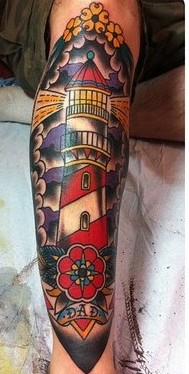 Sailor Jerry Lighthouse And Flower Tattoos On Leg