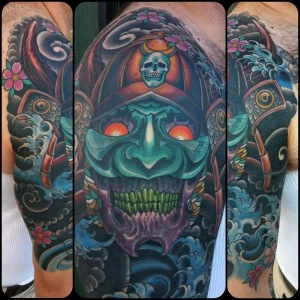 Samurai Skull With Helmet And Wave Tattoos On Half Sleeve