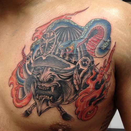 Samurai With Helmet And Snake Flame Tattoos On Chest