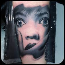 Scar Faced Portrait Tattoo
