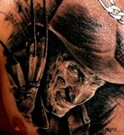 Scary Portrait Tattoo On Chest