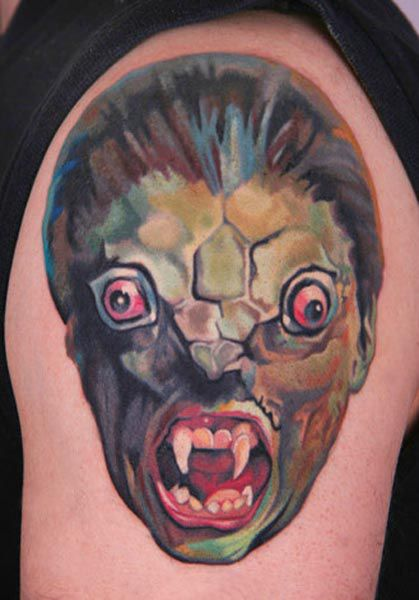 Scary Watercolor Face Tattoo On Biceps