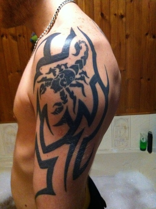 Scorpion In Tribal Tattoo On Arm