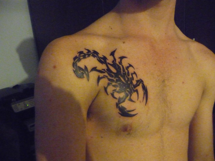 Scorpion Tribal Tattoo On Chest