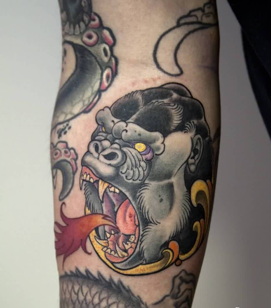 Screaming Animal Face Tattoo On Arm