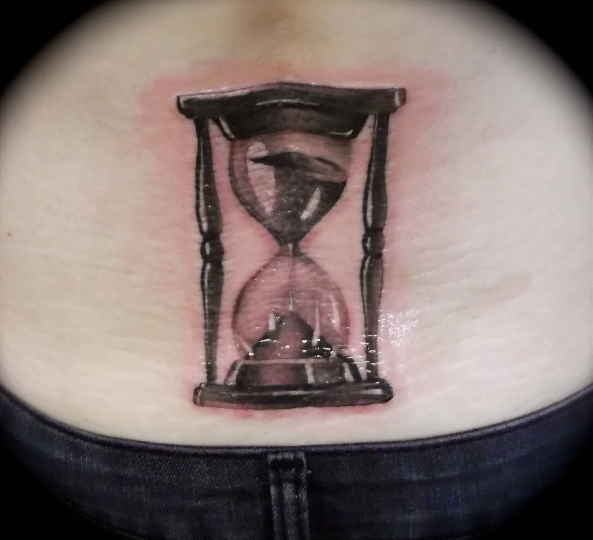 Shining Hour Glass Tattoo On Lowerback