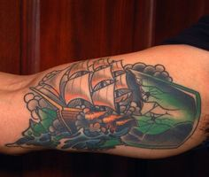 Ship And Broken Bottle Tattoos On Muscles