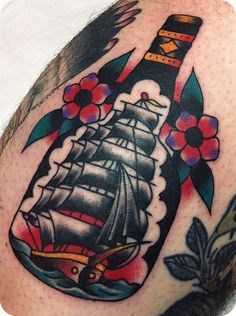Ship In Bottle Tattoo With Small Flowers