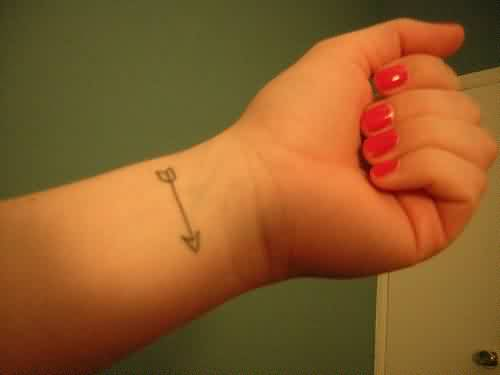 Simple Arrow Tattoo And Red Nails