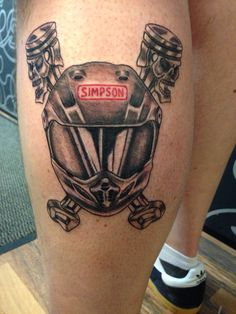 Simpsons Helmet And Piston Tattoos On Leg