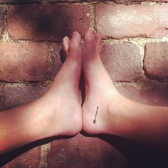Single Black Arrow Tattoo On Right Foot